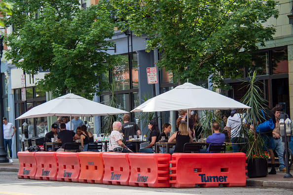 Cities let restaurants set up in streets to ease Covid-19 restrictions