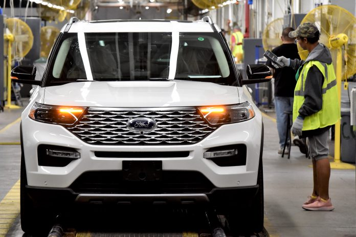 Ford closes two plants after three workers test positive for Covid-19