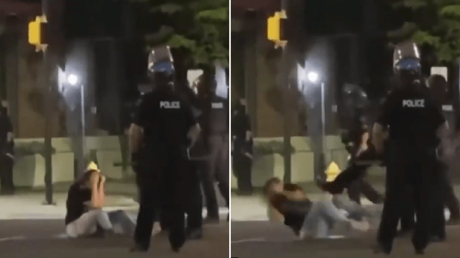 Moment cop kicks George Floyd protester on the ground 'after pepper-spraying her'