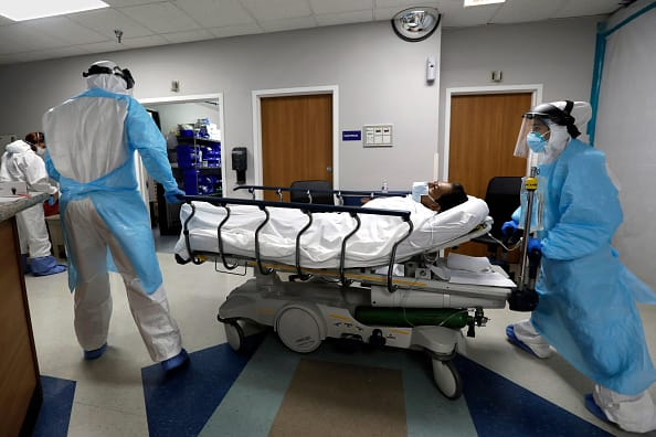 Texas hospitalizations jump; NYC offices eye high-tech safety measures