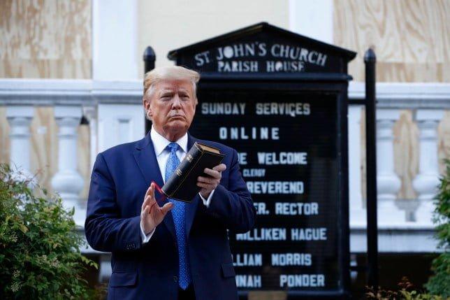 PHOTO OF DONALD TRUMP HOLDING BIBLE