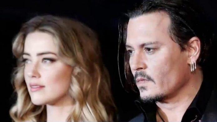 Actor Johnny Depp takes on U.K. tabloid in court battle over 'wife beater' claims