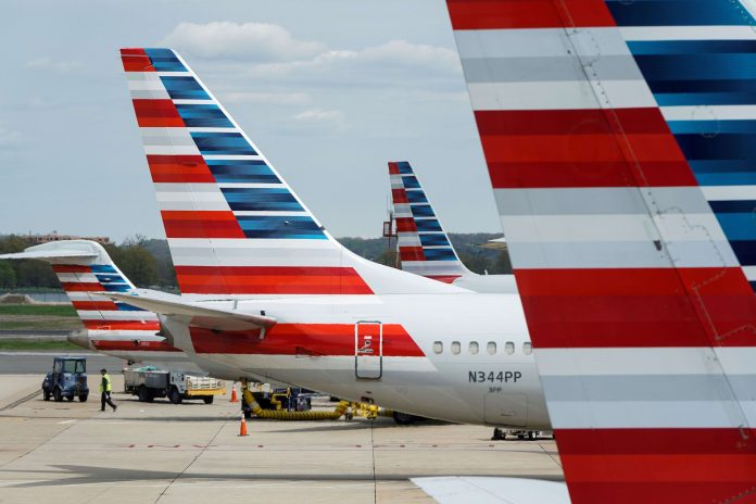 American Airlines backs unions in bid to extend billions in federal aid through March