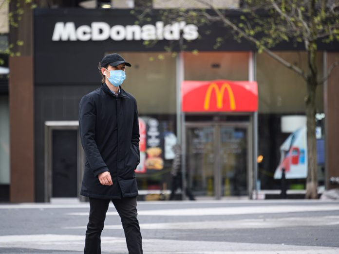 McDonald's continues pause on dining room reopenings, requires customers to wear masks