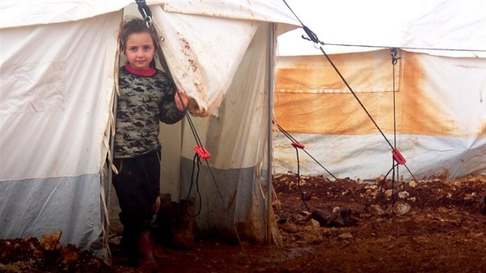 Refugees, Aid groups condemn U.N. decision to limit Syrian aid crossings