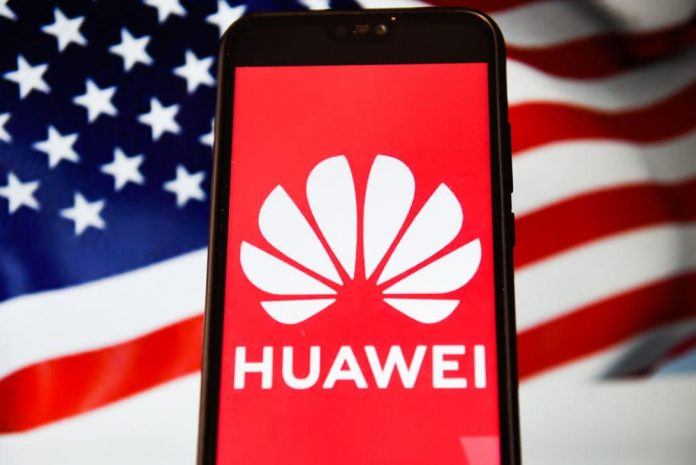 In this photo illustration a Huawei logo seen displayed on a