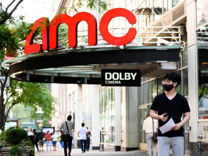 AMC shares spike as the movie theater chain preps to reopen next week