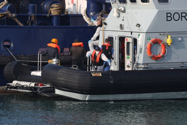 Two men thought to be migrants are brought into Dover, Kent, by Border Force officers following a small boat incident in the Channel earlier today. PA Photo. Picture date: Thursday August 13, 2020. See PA story POLITICS Migrants. Photo credit should read: Steve Parsons/PA Wire