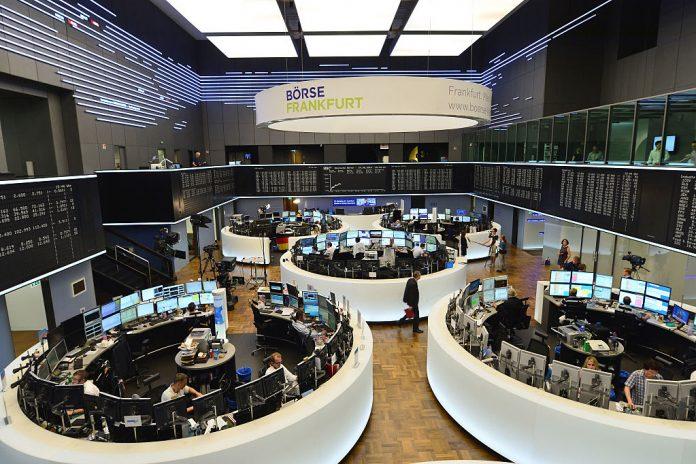 Investors react to economic data, corporate earnings