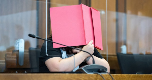 An unnamed mother sits in the dock at the regional court of Mönchengladbach in Germany on trial for killing her two-year-old son by leaving him in an overheated room to die of thirst in her flat in Grevenbroich, western Germany.