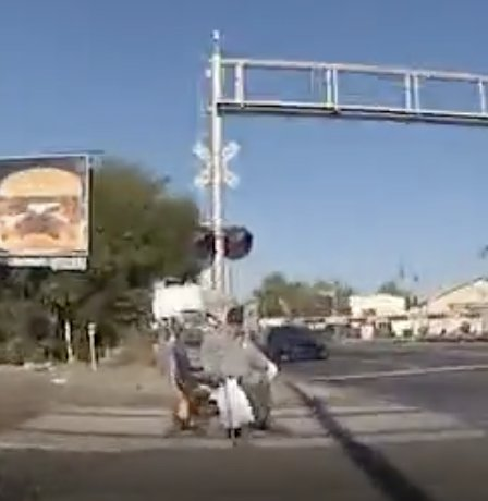 The insanely dramatic moment a police officer rescues a man in a wheelchair from an oncoming train with no seconds to spare