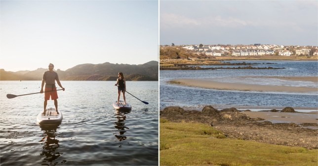 Stock image of paddle borders and Salthill houses and Silvestrand beach in Galway Bay, Salthill, Galway, Ireland