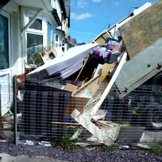PIC FROM Kennedy News and Media (PICTURED: THE PAIR DUMPED THE WASTE BACK ON TO THE DRIVE, INCLUDING MATTRESSES, DOORS AND BAGS OF RUBBISH.) Two 'furious' waste removal men filmed themselves dumping a truck load of a customer's rubbish over her driveway - as revenge when she reportedly refused to pay her bill. When Jonathan Morgan, 31, and his brother Calum, 27, turned up to a house in Cardiff on July 20, they thought they had a run of the mill removal job on their hands. The brothers, who run Cardiff Waste Removal & House Clearance, spent two hours clearing the mess, consisting of amongst other things a bed frame, mattresses, and doors before loading it all up on to their lorry. DISCLAIMER: While Kennedy News and Media uses its best endeavours to establish the copyright and authenticity of all pictures supplied, it accepts no liability for any damage, loss or legal action caused by the use of images supplied and the publication of images is solely at your discretion. SEE KENNEDY NEWS COPY - 0161 697 4266