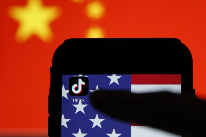 TikTok is 'caught in the middle' as the U.S. is 'deeply suspicious' of China, analyst says