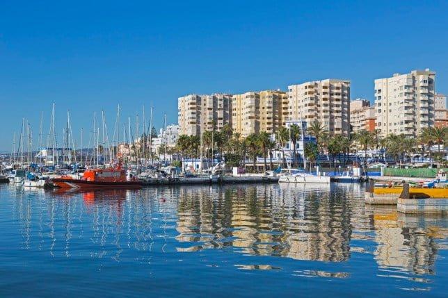 Estepona, Costa del Sol, Malaga Province, Andalusia, southern Spain. Harbor and apartment blocks.