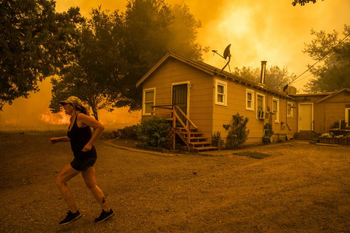 Wildfires rage across California threatening thousands of homes