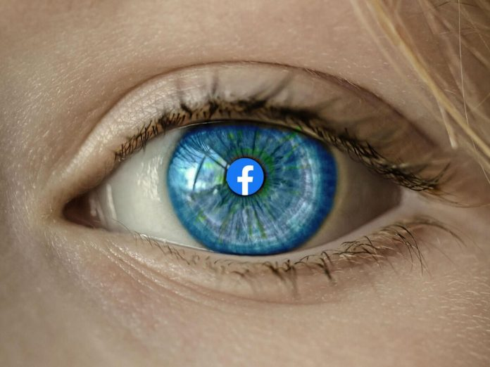 Human eye with a Facebook logo at the center of the pupil.