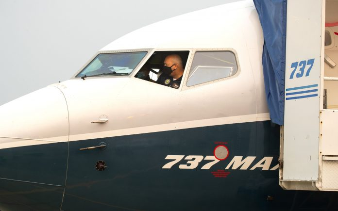 FAA chief upbeat after flying Boeing 737 Max, no timeline on approval