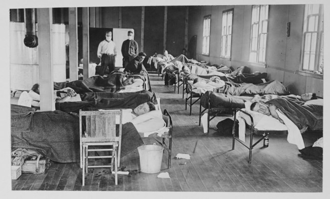 Victims of the Spanish flu as they lie in beds at a barracks hospital