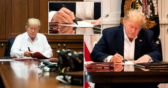 Donald Trump signs a blank sheet of paper