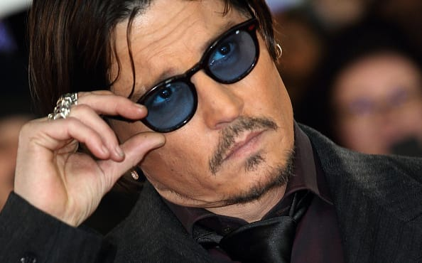 Actor Johnny Depp loses 'wife beater' libel case