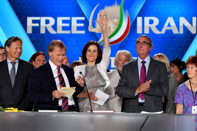 PARIS, FRANCE - JUNE 30: Theresa Villiers MP waves as Sir David Amess and the British delegation appear on stage during the Conference In Support Of Freedom and Democracy In Iran on June 30, 2018 in Paris, France. The speakers declared their support for the Iranian peoples uprising and the democratic alternative, the National Council of Resistance of Iran and called on the international community to adopt a firm policy against the mullahs regime and stand by the arisen people of Iran. (Photo by Anthony Devlin/Getty Images)