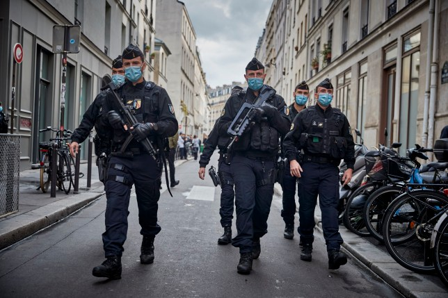 Armed police secure the area of around the former Charlie Hebdo headquarters