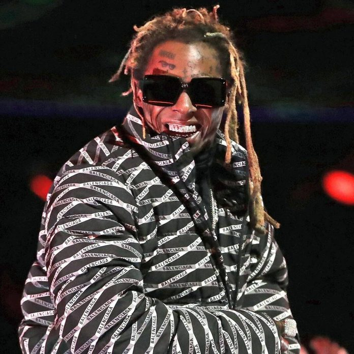 Lil Wayne Charged With Possession of Firearm and Ammunition - E! Online