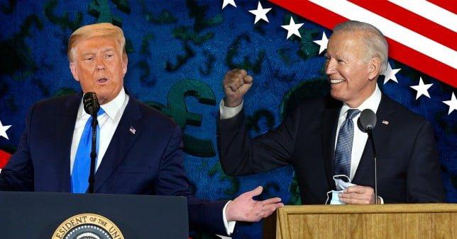 Joe Biden raises a fist in celebration as he stands alongside Donald Trump at a podium.