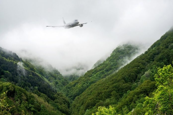 Airplane on Foggy Mountains in Toscana, Italy.