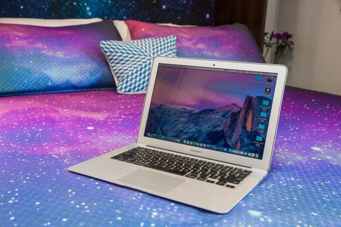 12-laptop-on-bed-work-from-home-coronavirus