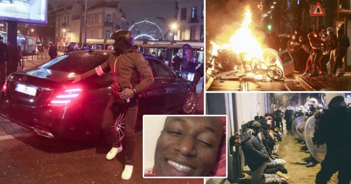 Protesters hit king's car with rocks in riots after death of black man being held