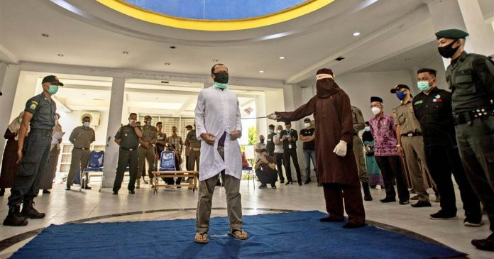 Two men publicly caned 77 times for having sex in Indonesia