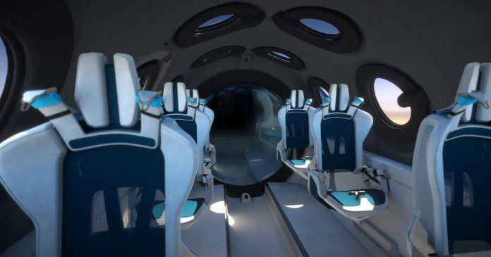 Virgin Galactic unveils its spaceship cabin where tourists will ride to orbit - Video