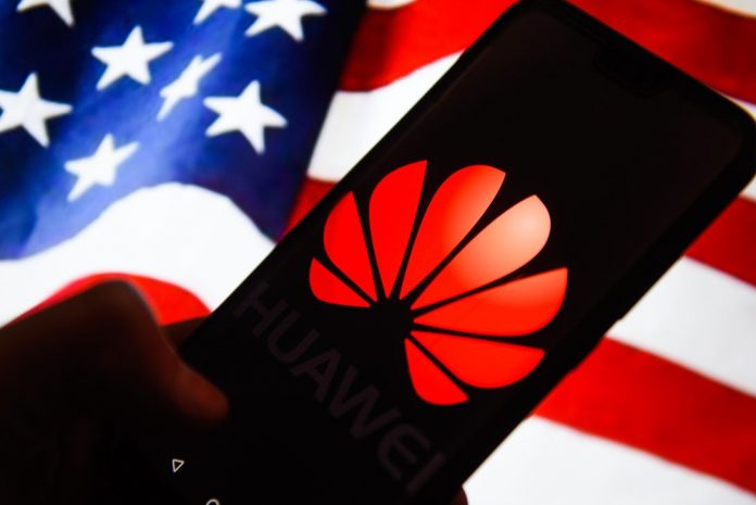 Huawei  logo is seen on an android mobile phone with United