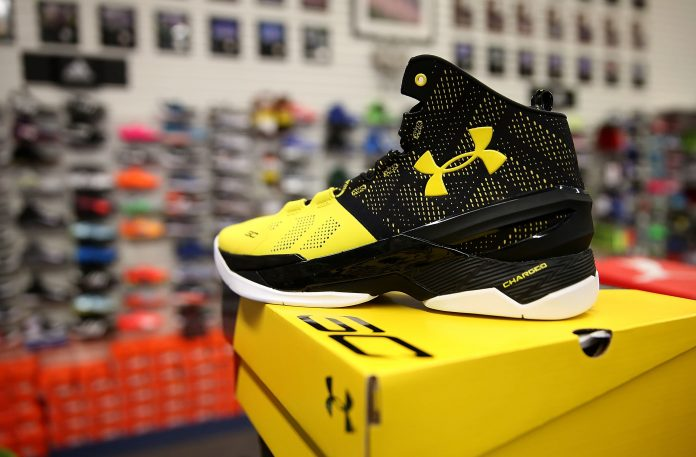 Under Armour pursues plans to break ties with some retailers; shares rally
