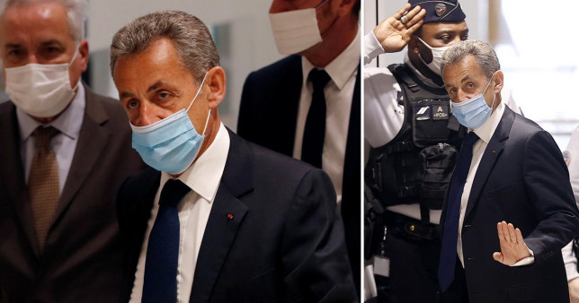 Nicolas Sarkozy arrives at the Paris court house to hear the final verdict in a corruption trial