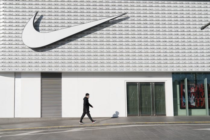 Nike shares fall after mixed earnings report, layoffs news