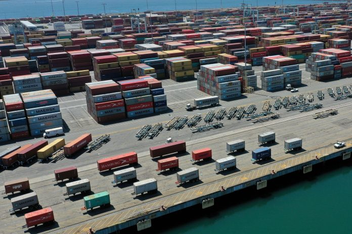 Retailers pay to fly goods from China as U.S. port backup delays deliveries