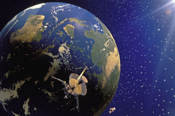 Computer Manipulated Image: Galileo & Magellan Satellites And Planet Earth.