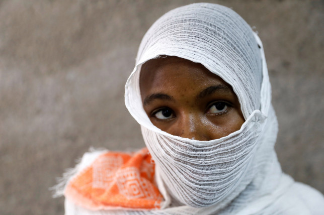 An Ethiopian woman who says she was gang-raped by armed men is seen during an interview with Reuters in a hospital in the town of Adigrat, Tigray region, Ethiopia, March 18, 2021. The Ethiopian government did not respond to the woman???s specific allegations but promised perpetrators of sexual violence would be punished. Picture taken March 18, 2021. REUTERS/Baz Ratner