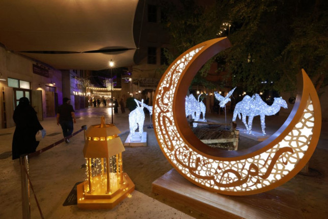 traditional lantern and crescent moon decorations put in place and lit in the Seef district of Dubai ahead the Muslim holy fasting month of Ramadan.