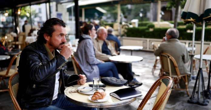 France reopens cafe and bistro terraces after six-month Covid shutdown