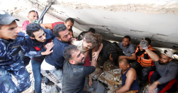 Suzy Eshkuntana, 6, is pulled from the rubble of her home after an Israeli air strike on Gaza.