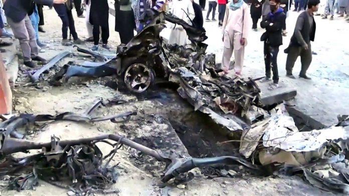 Grief and despair in Afghanistan neighbourhood as it buries girls killed in bombings