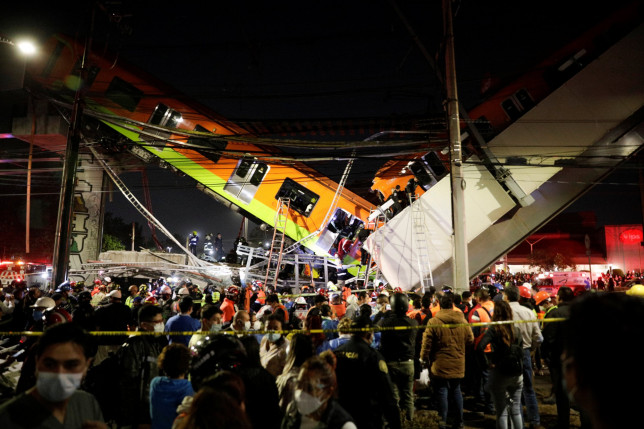 Rescuers work at a site where an overpass for a metro partially collapsed with train cars on it at Olivos station in Mexico City, Mexico May 03, 2021. Luis Cortes/REUTERS