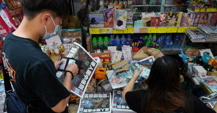 Hong Kong police arrest Apple Daily journalist at airport days after newspaper's closure