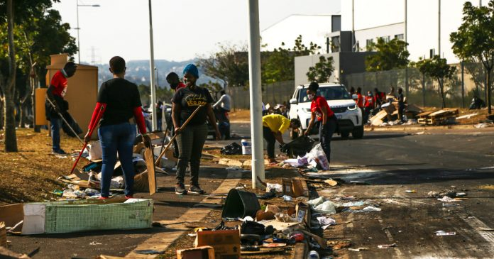 After deadly riots in South Africa, army of volunteers leads defense, cleanup efforts