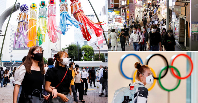 People wear face masks while out in Tokyo during a surge in Covid infections