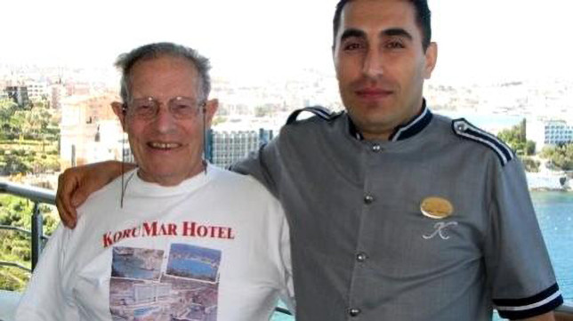 British tourist Charles George Courtney (left) who spent his holiday at the Korur Hotel in Kusadasi district of Aydin in Turkey, in a photo with the bellboy Taskin Dasdan (right). (Newsflash)